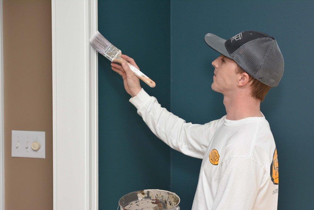 Garrett Painting employee working on trim