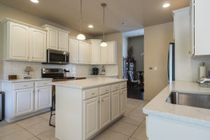 white galley kitchen cabinets repainted