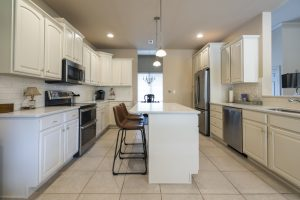 white galley kitchen repainted