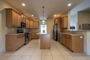 outdated galley kitchen cabinets